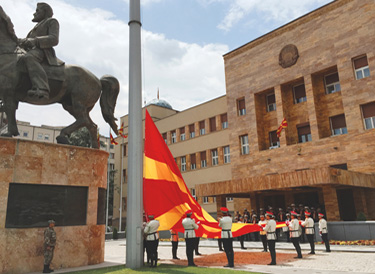 Ceremonial flag change in front of the Assembly of the Republic of Macedonia. Photo: Kosta Stamatovski.